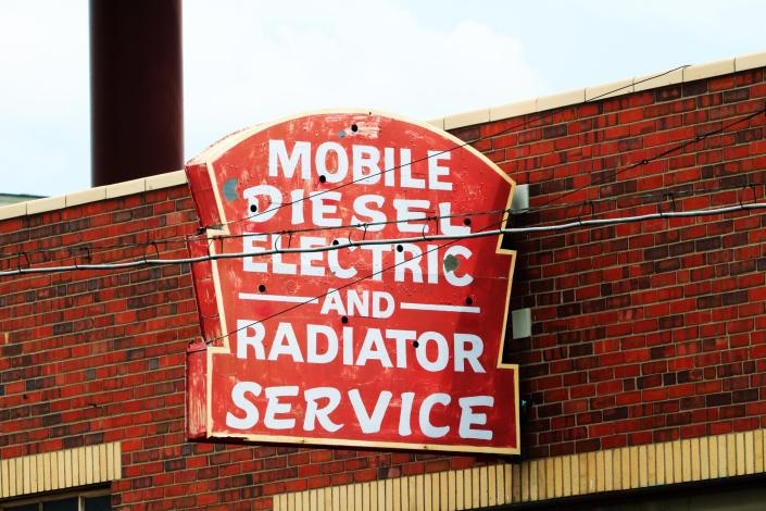 Old Mobile Diesel Electric and Radiator Service Neon Sign LODO Denver Colorado